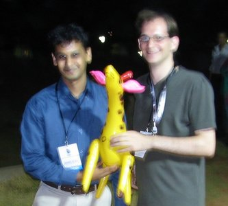 Chamindra and Martin with a toy giraffe